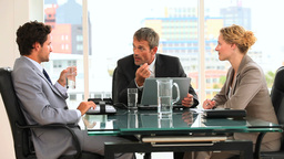 Threesome of business people during a meeting Footage
