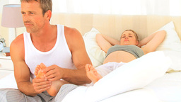 Man massaging his wifes feet Stock Video Footage