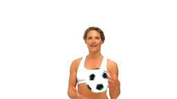 Curly haired woman playing with a soccer ball Footage