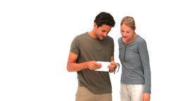 Woman offering a watch to her husband Stock Video Footage
