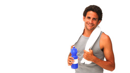 Darkhaired man with a towel and flask Stock Video Footage