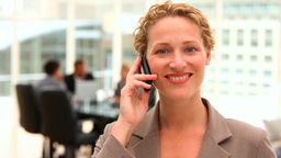Blonde business woman talking on the phone Footage