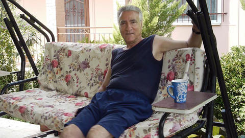 Old retired man on porch swing - Leisure Stock Video Footage