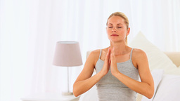 Casual woman doing yoga Stock Video Footage