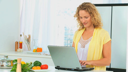 Curly haired woman looking at a recipe Footage
