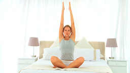 Wonderful blonde woman doing yoga Stock Video Footage