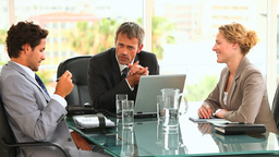 Three business people during a meeting Stock Video Footage