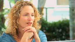 Curly blond haired woman thinking Footage