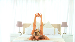 Blonde woman stretching herself Footage