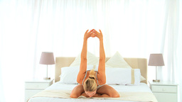 Blonde woman stretching herself Stock Video Footage