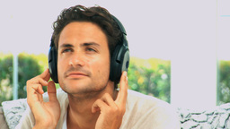 Handsome man listening to music Stock Video Footage