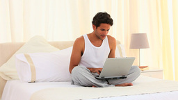 Dark haired man sitting with his laptop Stock Video Footage