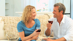 Couple savouring a red wine Footage