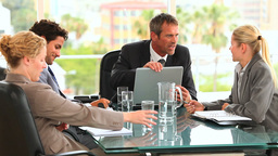Four people during a business meeting Stock Video Footage