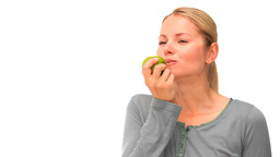 Good looking woman eating an apple Stock Video Footage