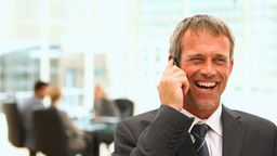 Middle aged business man talking on the phone Stock Video Footage