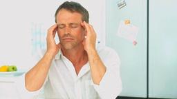 Middle aged man having an headache Footage