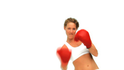 Curly haired woman with boxing gloves Footage