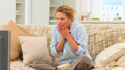 Stressed woman getting nervous in front of her tv Footage