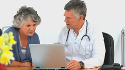 Doctor with his patient looking at the laptop Footage