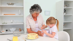 Grandmother with her granddaughter baking Footage
