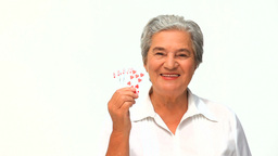 Mature woman holding cards Stock Video Footage