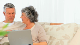 Retired couple looking at their laptop Stock Video Footage