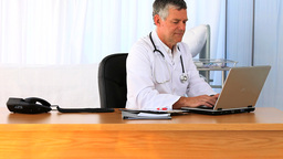 Doctor working on his laptop Footage
