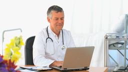 Doctor working on his laptop Stock Video Footage