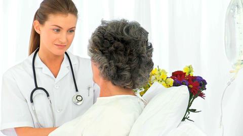 Nurse talking with her female patient Stock Video Footage