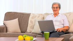 Senior woman working on her laptop Footage