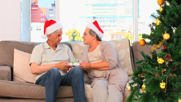 Woman offering a present to her husband Stock Video Footage