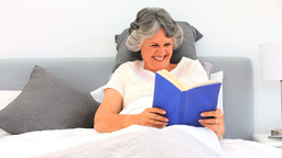 Woman reading her book Stock Video Footage
