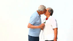 Man offering a rose to his wife Footage