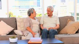 Mature couple talking on the sofa Footage