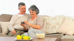 Mature couple looking at their camera Stock Video Footage