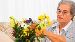 Senior Woman Making A Bunch Flowers stock footage
