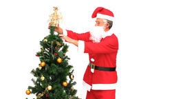 Santa Claus decorating the Christmas tree Footage