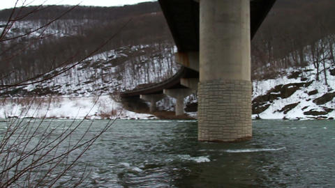 Under Bridge, Mountain And River stock footage