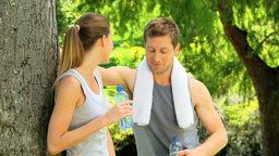Athletic couple having a drink of water Footage
