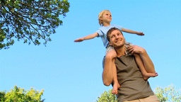 Little boy sitting on his fathers shoulders Footage