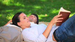 Couple lying on the grass Footage