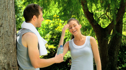 Athletic woman joining boyfriend after a jog Stock Video Footage