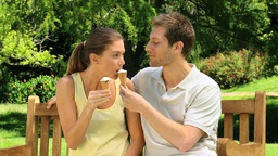 Attractive couple eating ice creams Footage