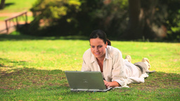 Woman using a laptop outdoors Footage