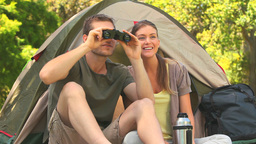 Man looking through binoculars Footage