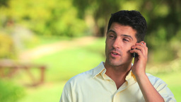 Relaxed man talking on a phone outdoors Stock Video Footage
