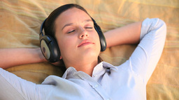 Relaxed woman listening to music outdoors Stock Video Footage