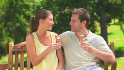 Attractive couple eating ice creams Stock Video Footage