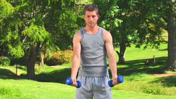 Athletic man doing exercises outdoors Footage
